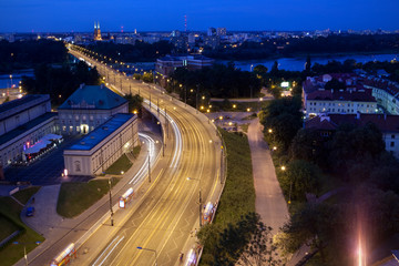 Vistula river and traffic at night in Warsaw's old town. Poland