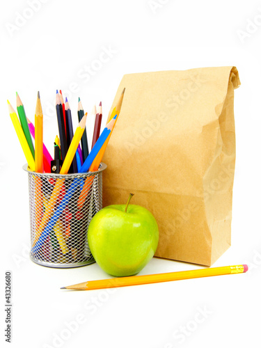 School lunch bag with apple, pencil and school supplies