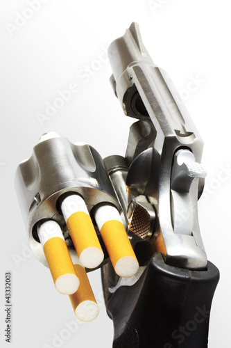 Revolver with cigarette bullets (clipping path)