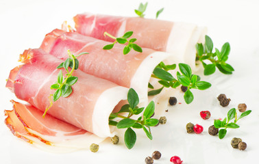 Slices of bacon and herbs