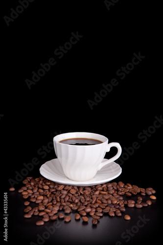 Papiers peints Café en grains White cup with hot liquid on black (copy space above)