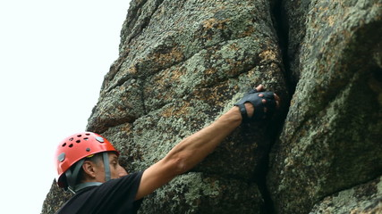 Man climbing a rock face