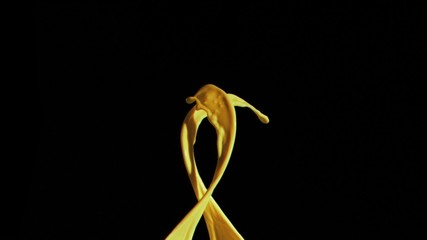 Yellow paint in super slow motion appearing