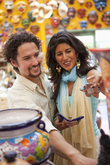 Couple shopping for souvenirs together