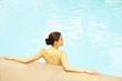 Caucasian woman relaxing in swimming pool