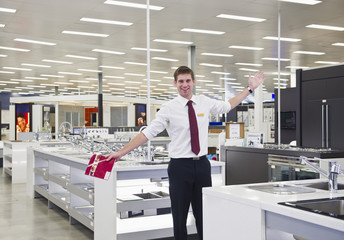 Caucasian salesman standing in home supply store