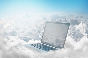 Laptop floating in clouds