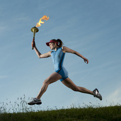 Caucasian athlete running with Olympic torch