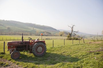 Old-fashioned tractor in farm field