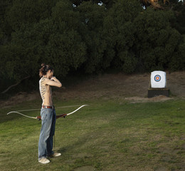 Mixed race archer with bow looking at target