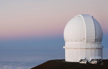 Observatory on hilltop over ocean