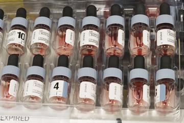 Blood in dropper bottles in tray