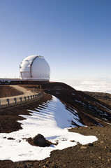 Observatory on snowy hilltop