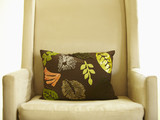 Decorative pillow on armchair