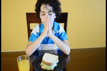Young Latino Boy Praying for the Food