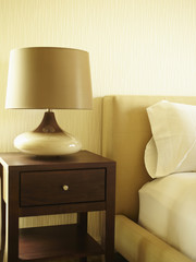 Modern lamp on side table in bedroom