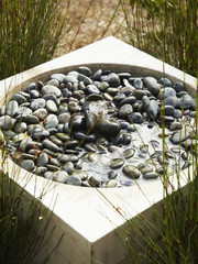 Modern pebble-filled water fountain