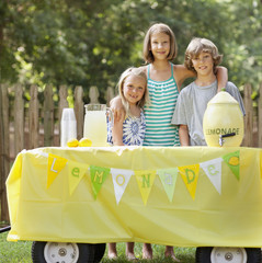 Caucasian children with lemonade stand