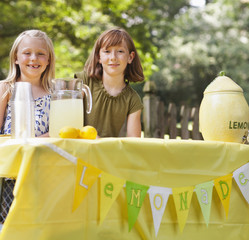 Caucasian girls with lemonade stand