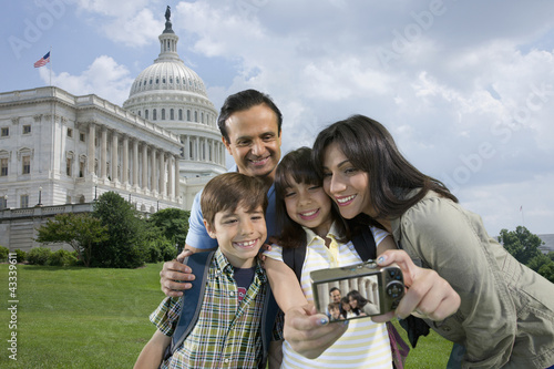 Family taking self-portrait on vacation