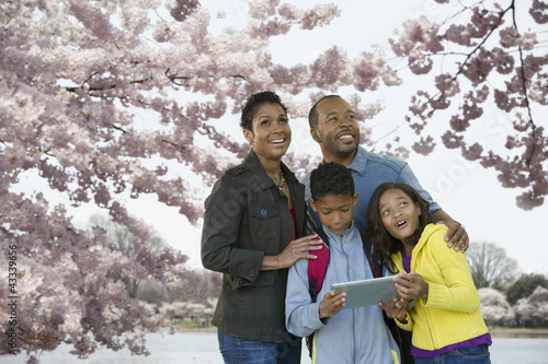 African American family using digital tablet on vacation