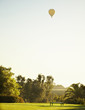 Hot air balloon over lawn