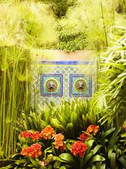 Mosaic fountain in tropical garden