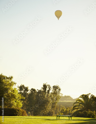 Hot air balloon over lawn