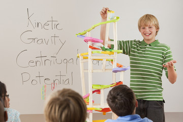 Boy talking about gravity in classroom