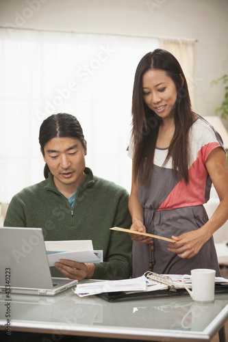 Korean couple paying bills together