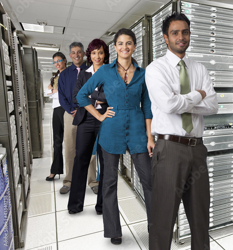 Business people standing together in server room