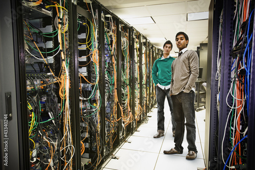Businessmen standing together in server room