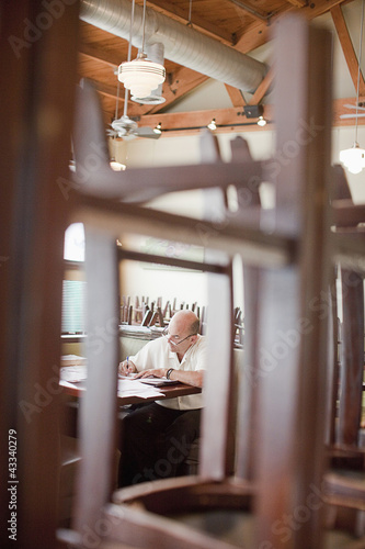 Caucasian restaurant owner working in booth