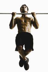 Caucasian man doing pull-ups