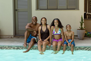 African American family enjoying swimming pool