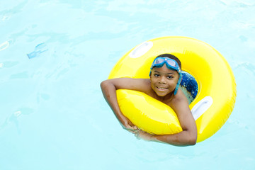 African American boy playing in swimming pool