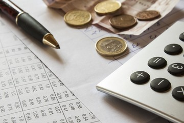 financial composition on the table with money, calculator