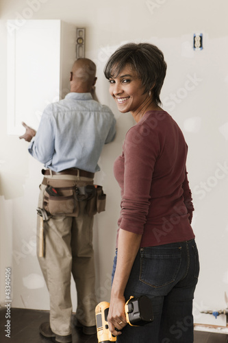 Couple working in unfinished room