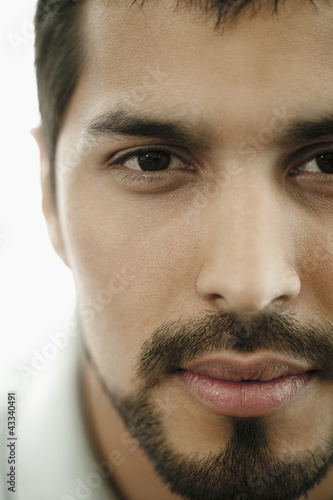 Close up of serious man with beard