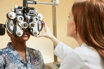 Optician adjusting equipment for patient
