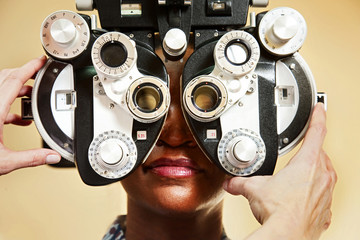 Optician adjusting equipment for patient