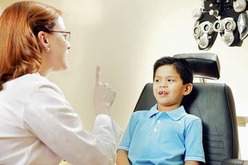 Optician examining patient's vision