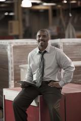Black businessman working in warehouse