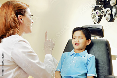 Optician examining patient's vision