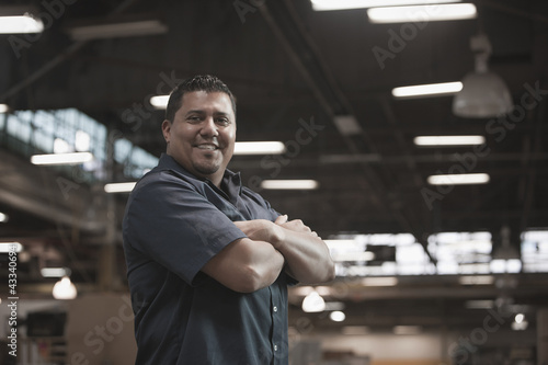 Hispanic worker standing in warehouse