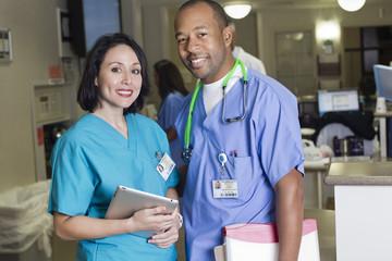 Smiling doctors standing in hospital
