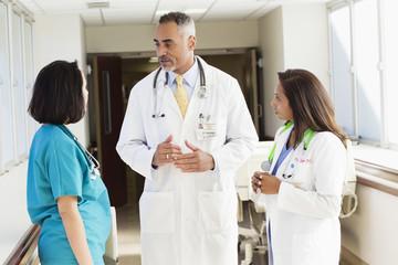 Doctors and nurse talking in hospital