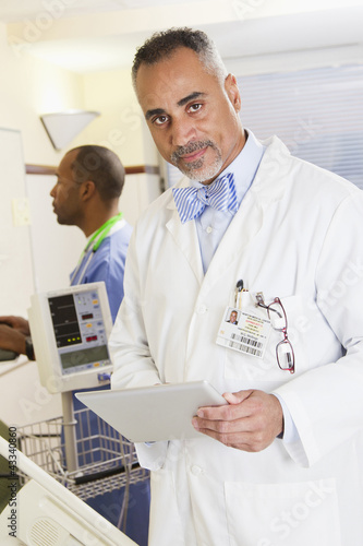 Doctor holding digital tablet in hospital