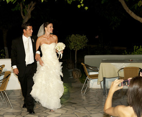 Bridal couple arriving at reception