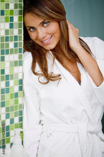 Hispanic woman wearing bathrobe